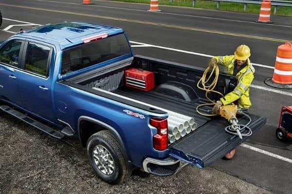Blue 2021 Chevrolet Silverado 2500HD Crew Cab on a Roadside Work Site_mobile