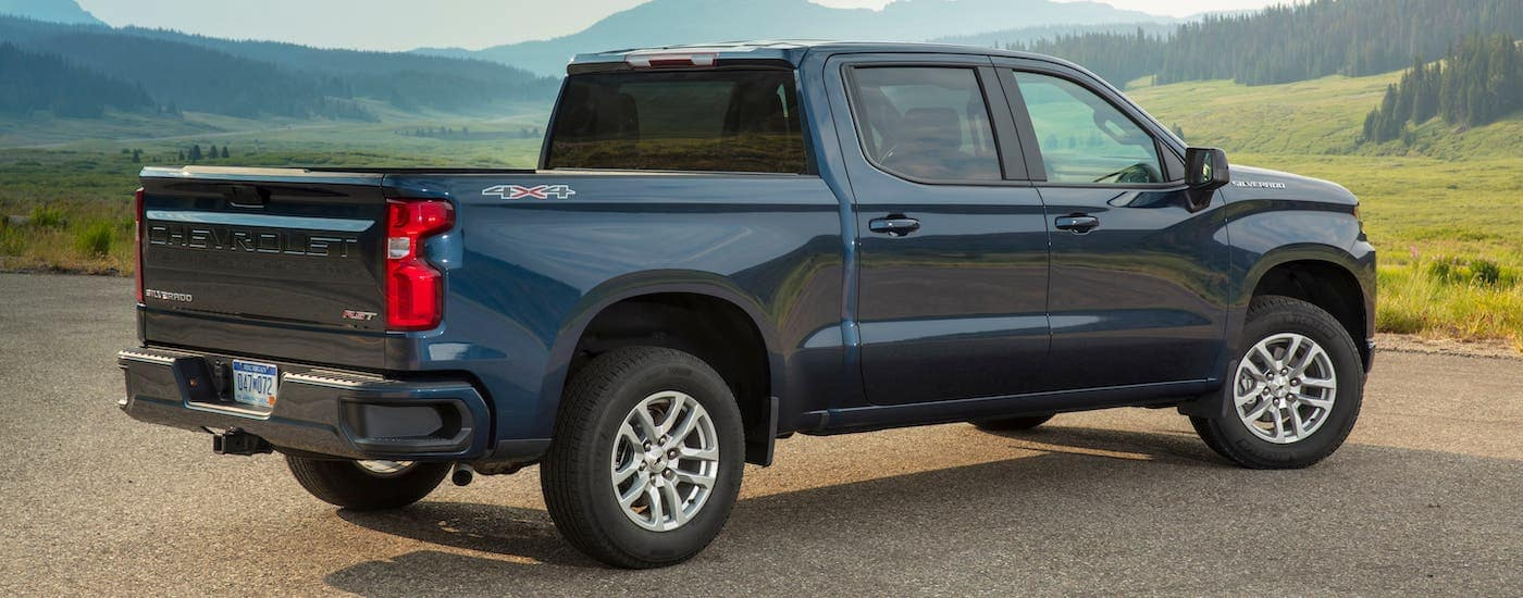 A blue 2020 Chevy Silverado RST is parked overlooking a field.