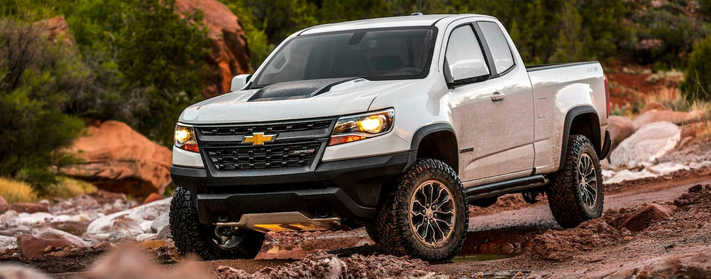 One of the popular Chevy Trucks, a white 2020 Chevy Colorado ZR2, is kicking up mud on a trail outside Indianapolis, IN.