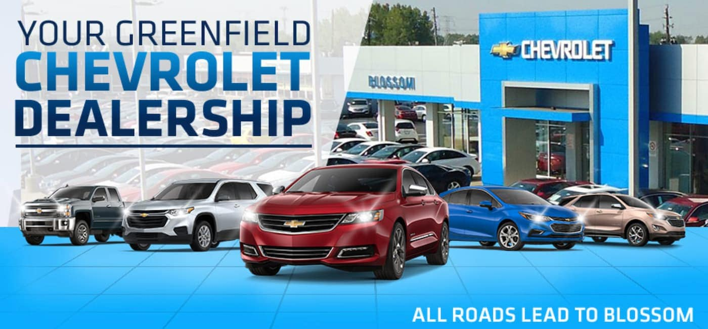 Five Chevy models are shown in front of Blossom Chevrolet, with 'Your Greenfield Chevrolet Dealership' written at the top.