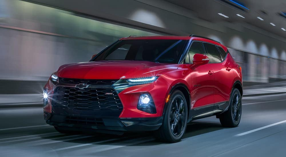 A red 2020 Chevy Blazer is driving through a tunnel after leaving an Indianapolis Chevy dealer.