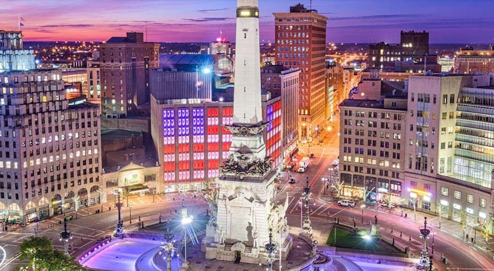 Downtown Indianapolis is lit up at night.