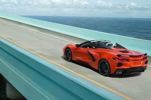 Red 2020 Chevrolet Corvette Stingray Convertible Driving on an Ocean Highway_mobile