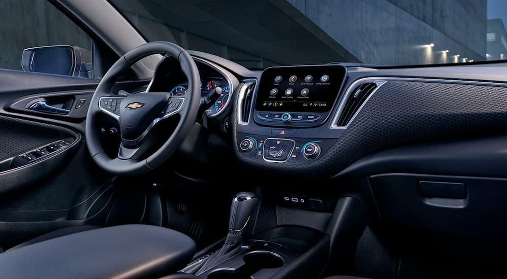 The black interior is shown in a 2019 Chevy Malibu, which features the infotainment screen.