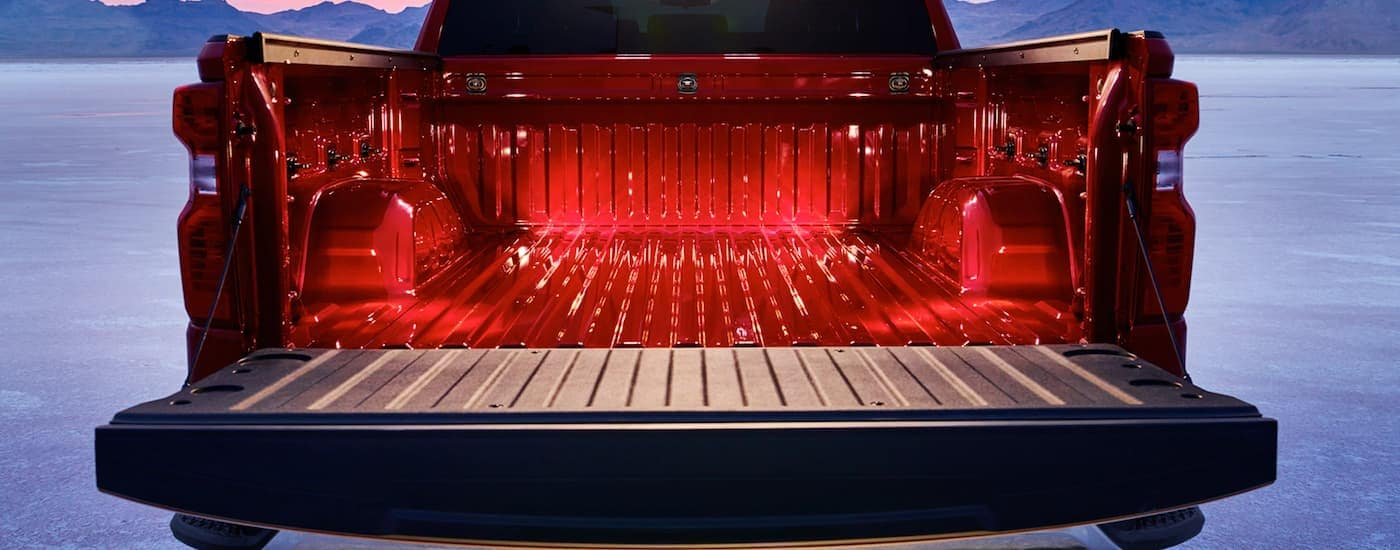 A red 2020 Chevy Silverado 1500 is shown with a view of the bed to show the 2020 Chevy Silverado Truck Bed Dimensions.