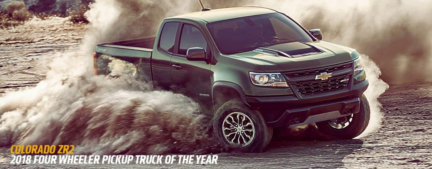 A dark grey 2018 Chevy Colorado ZR2 is off-roading with the award listed below.