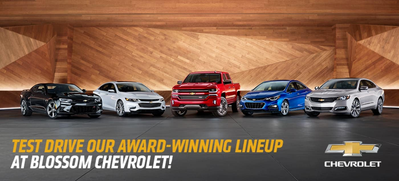 Five vehicles from the Chevy Motor Trend Award-winning lineup are shown in a showroom.