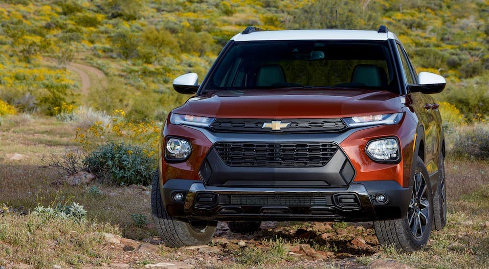 A red 2021 Chevy Trailblazer is driving on a rocky path.
