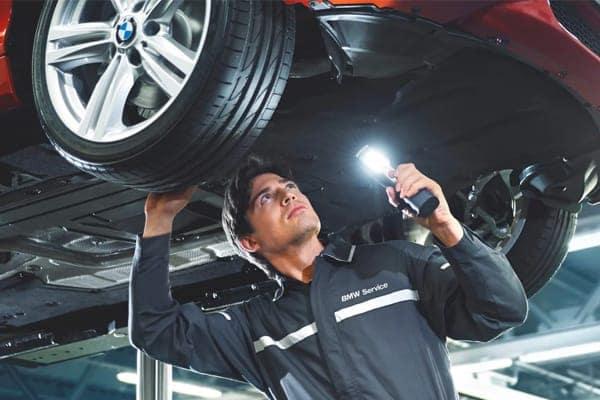 mechanic under car
