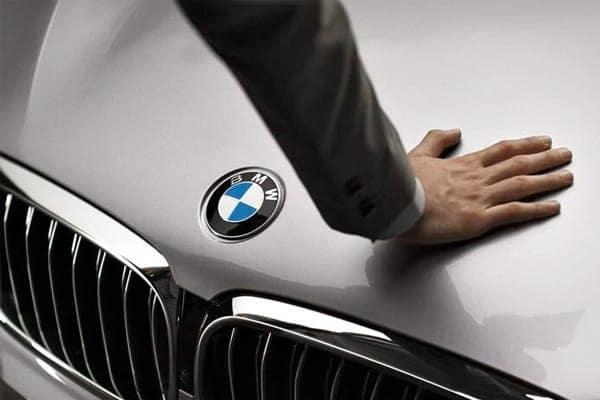 Hand on hood of car
