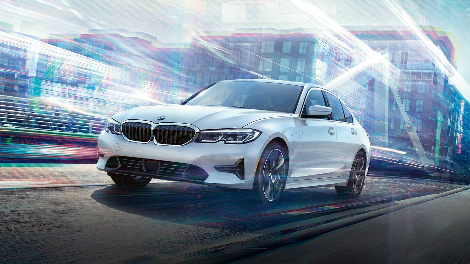 white 3Series drives past polychromatic city buildings