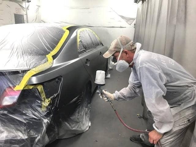 technician spraying car body