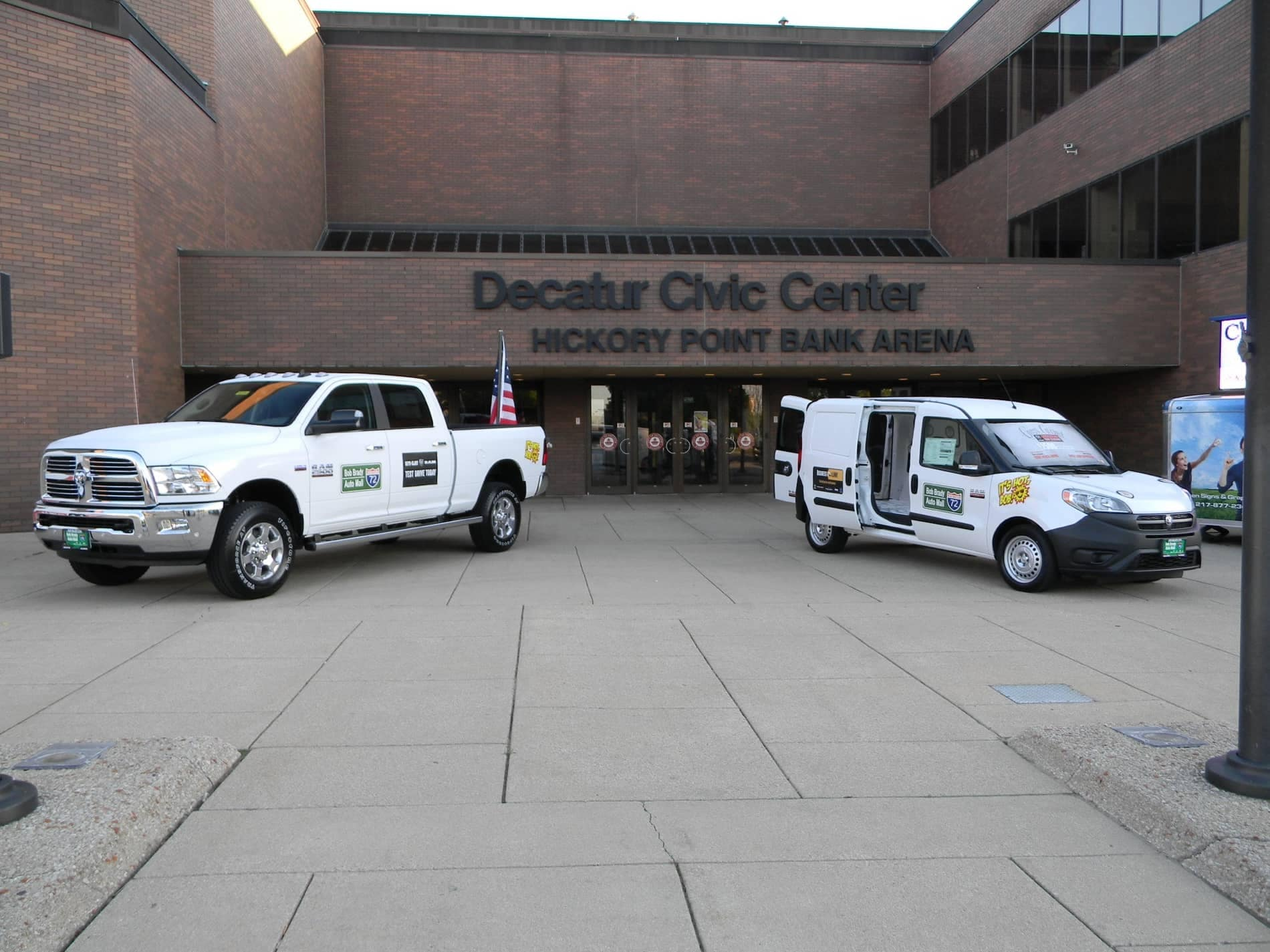 Truck and Van with upfit parked in front of Decatur Civic Center