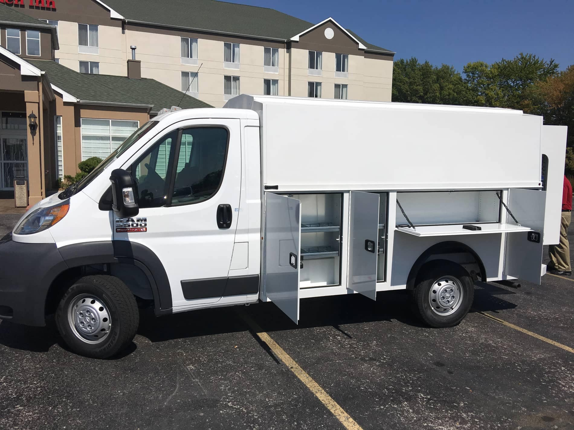 Van with upfit kit and shelves on side