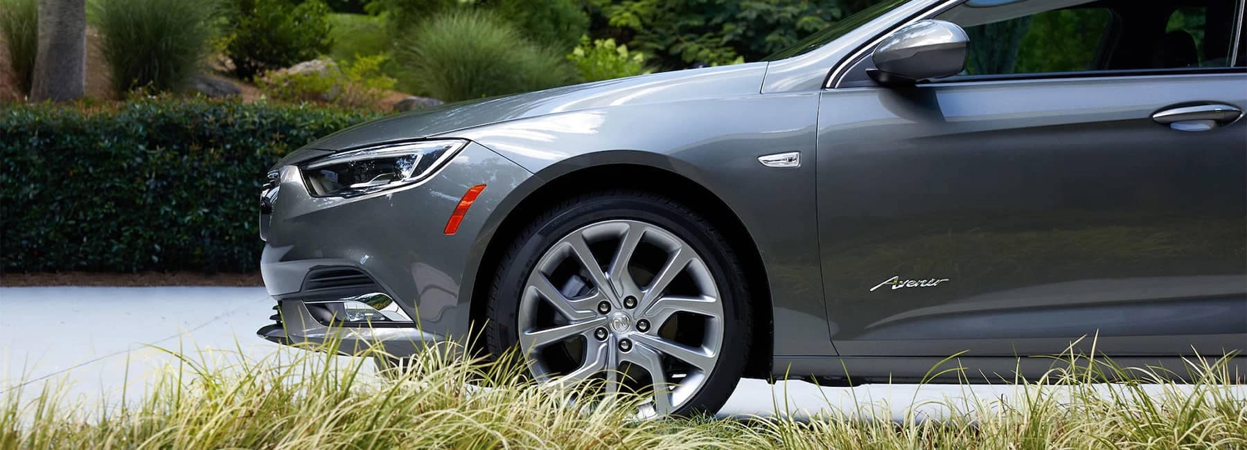 2020 Buick Regal Avenir Sportback Luxury Sedan exterior side obscured wheel view