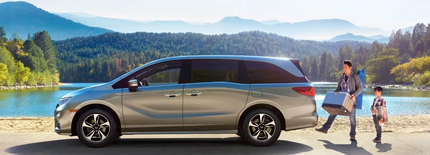 2021 Honda Odyssey Sideview in front of lake