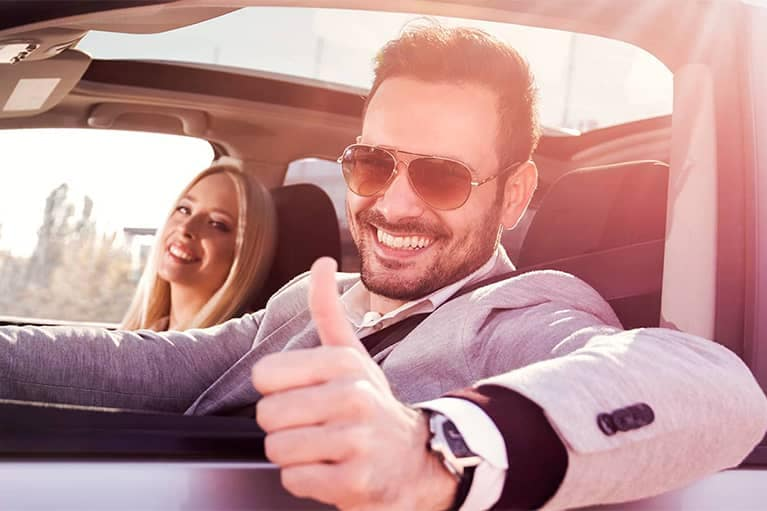 Man Driving Car Giving Thumbs Up