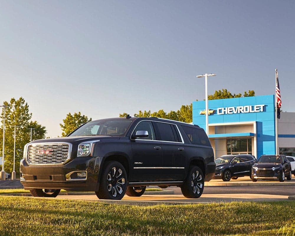 GMC Denali parked out front of the dealership