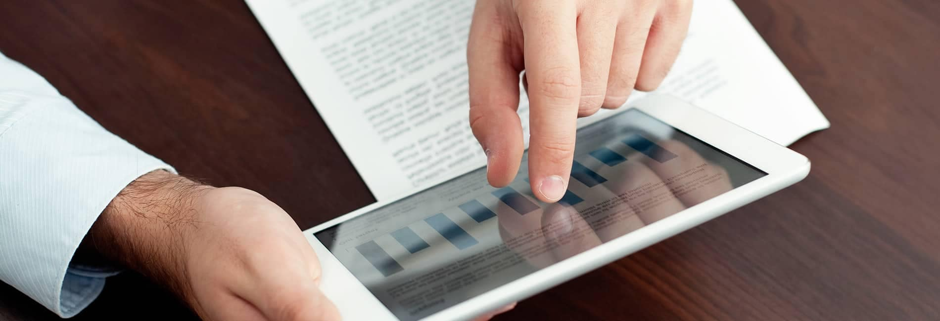 Person using tablet with graphs