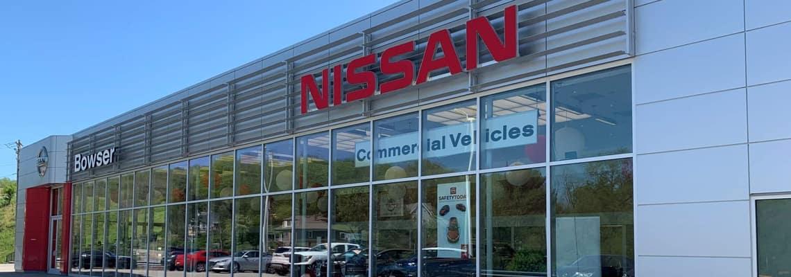 An exterior shot of a Nissan dealership