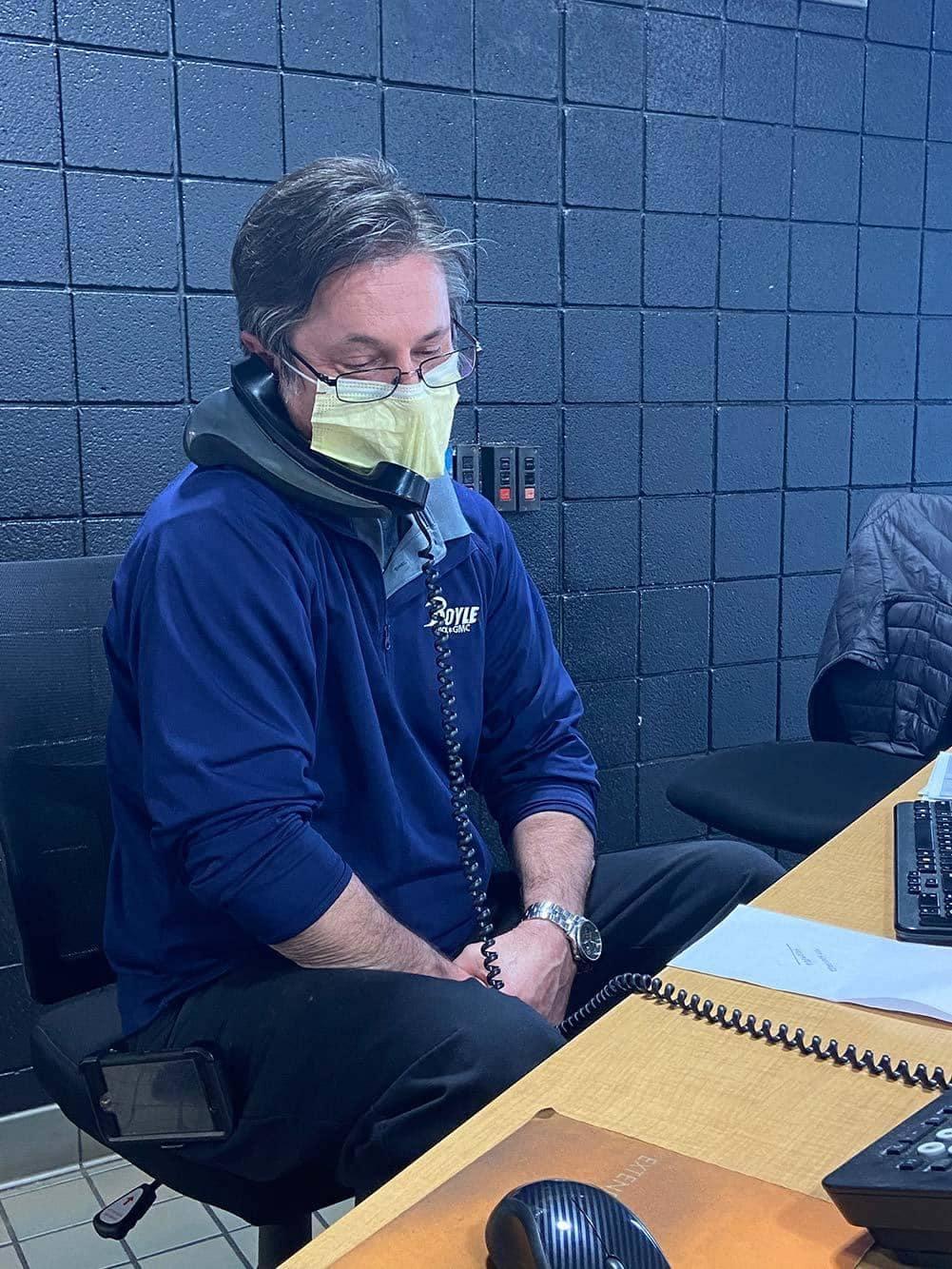 Dealership employee wearing mask