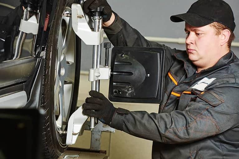mechanic-performing-a-tire-service-on-a-vehicle