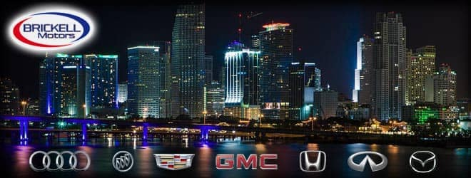 Brickell Motor dealership logos set in front of cityscape