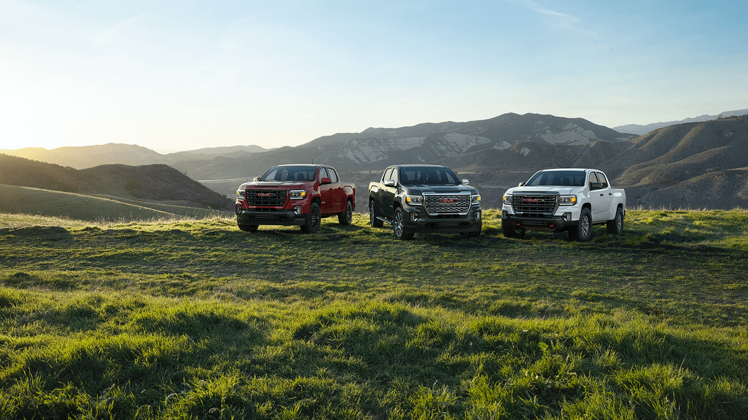 2020 GMC Canyons parked on grassy hill