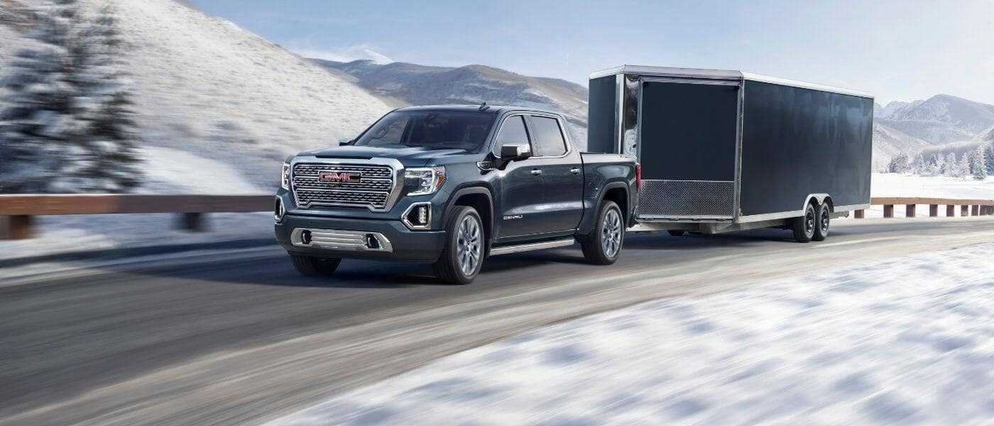 GMC Sierra 1500 towing a trailer