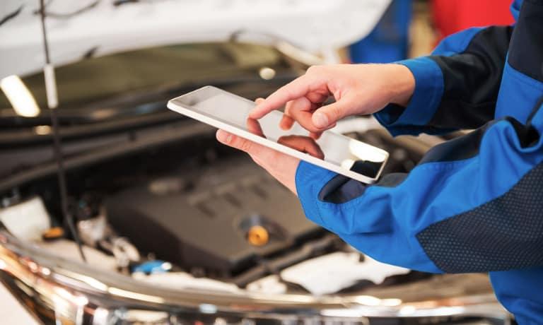 A mechanic using an ipad