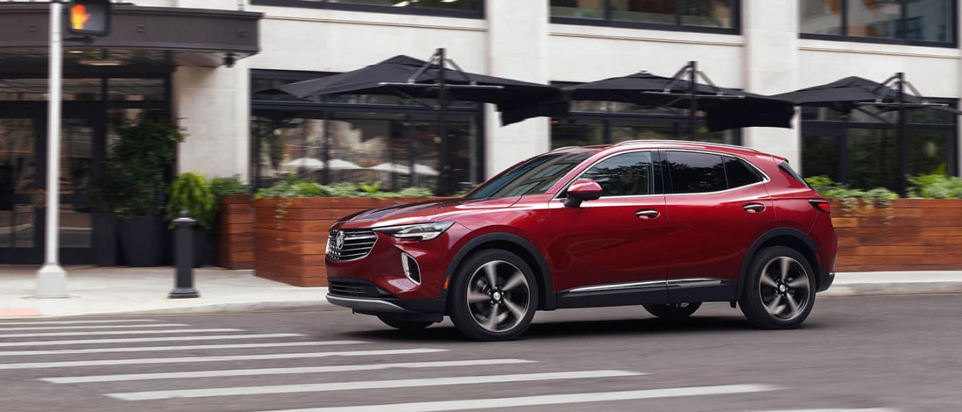 2021 Buick Enision in red exterior city block