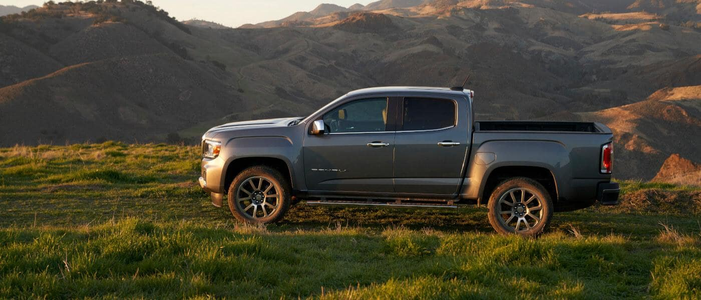 2021 GMC Canyon in grey exterior by grassy field