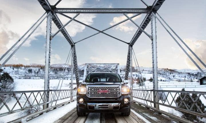 GMC Denali crossing snowy bridge