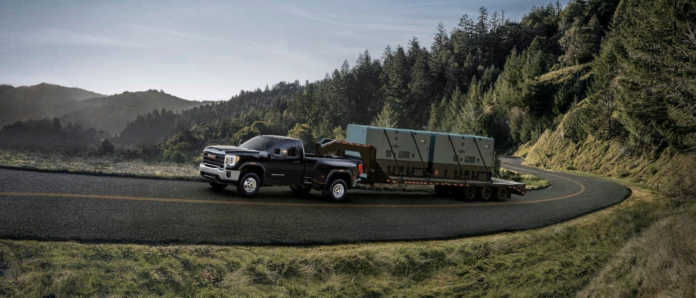 GMC Sierra 3500hd towing transformers through mountains