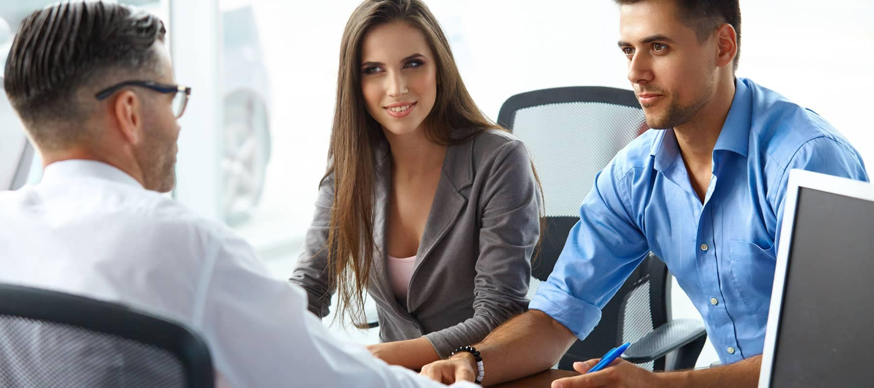 picture of a couple talking with a finance manager