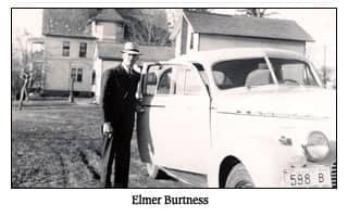 Elmer Burtness posing in a black and white photo
