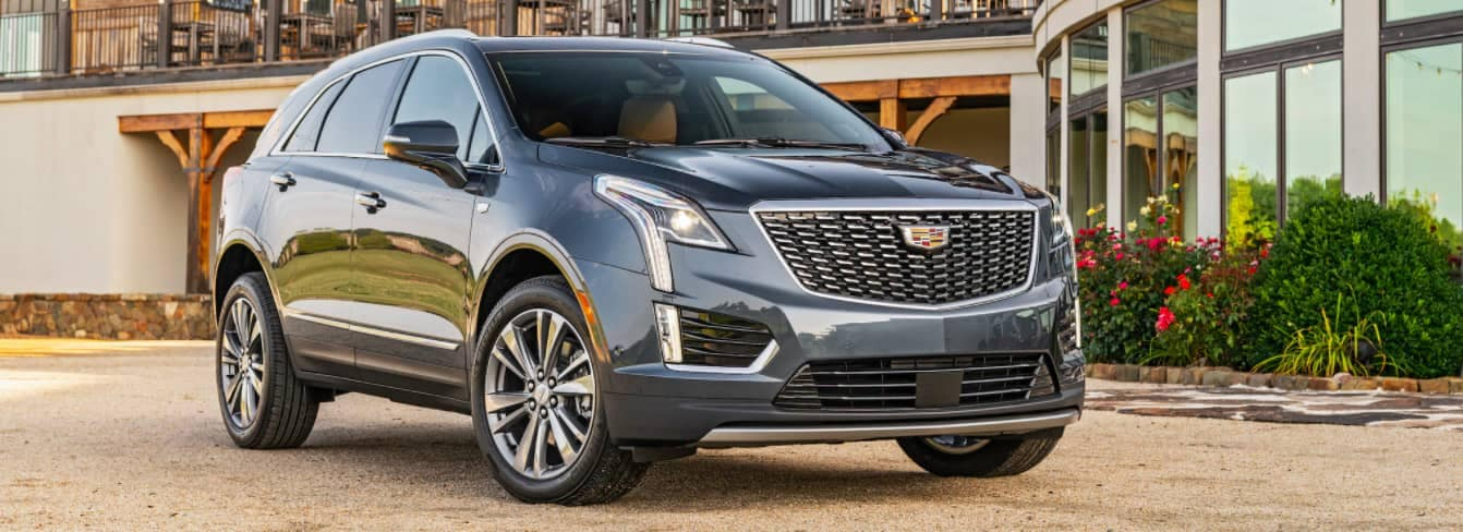 2020 Cadillac XT5 parked infront of modern building