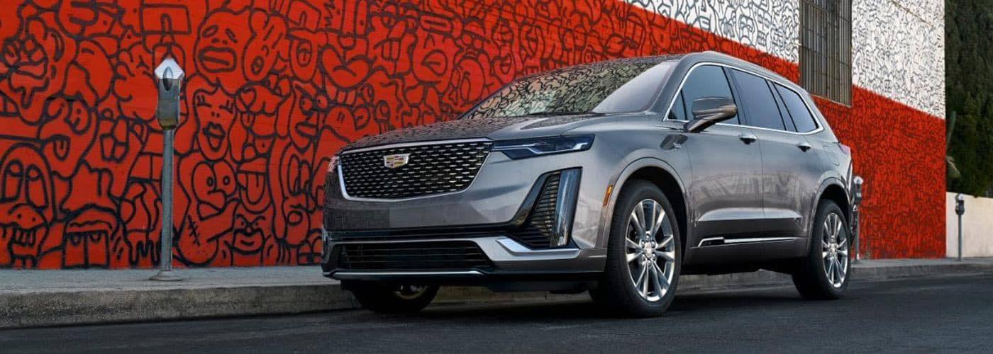 2021 Cadillac XT6 dark grey color parked in front of art wall