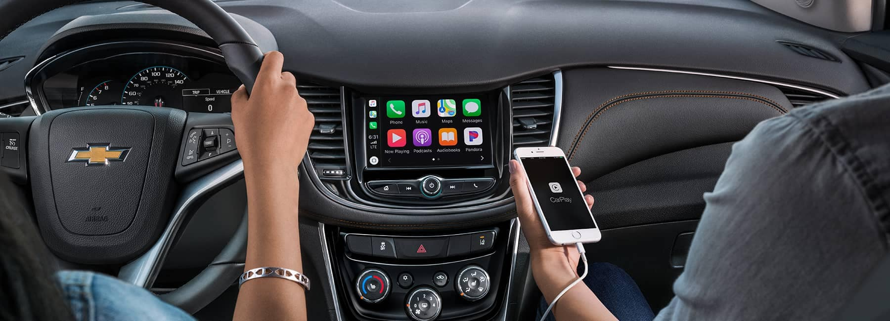 2020 Chevrolet Trax Interior Dashboard, person using cellphone