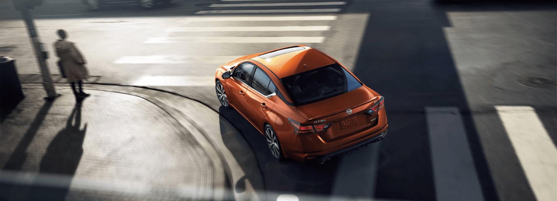 2020 Nissan Altima turns city corner
