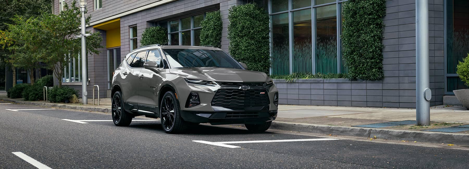 2021 Chevrolet Blazer parked in front of a city building_mobile