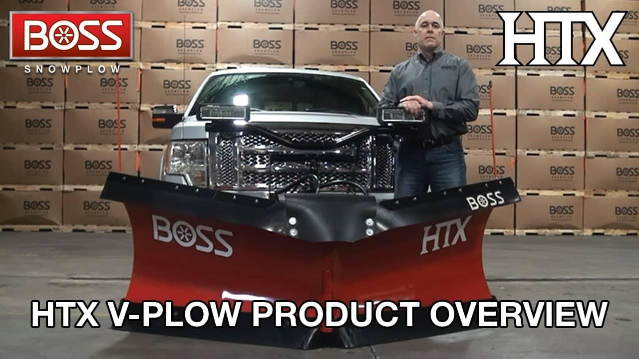 man in front of snow plow