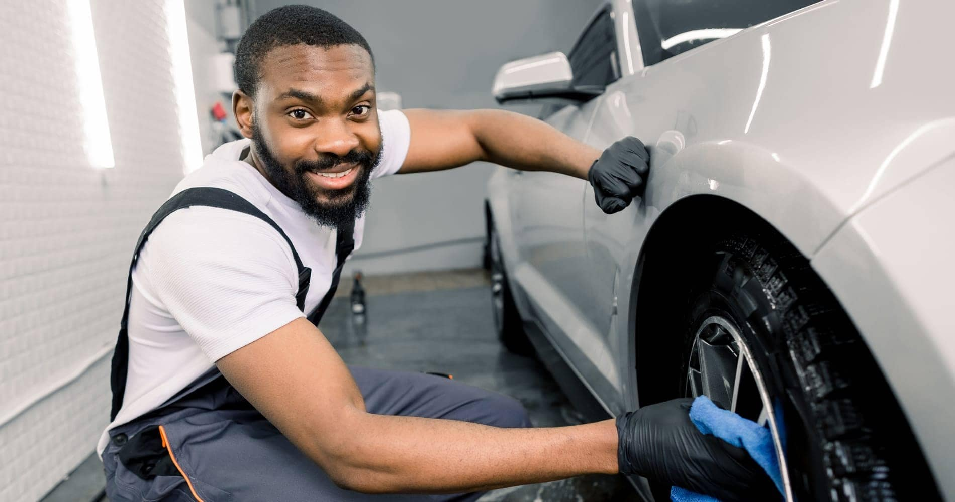 service technician working on vehicle