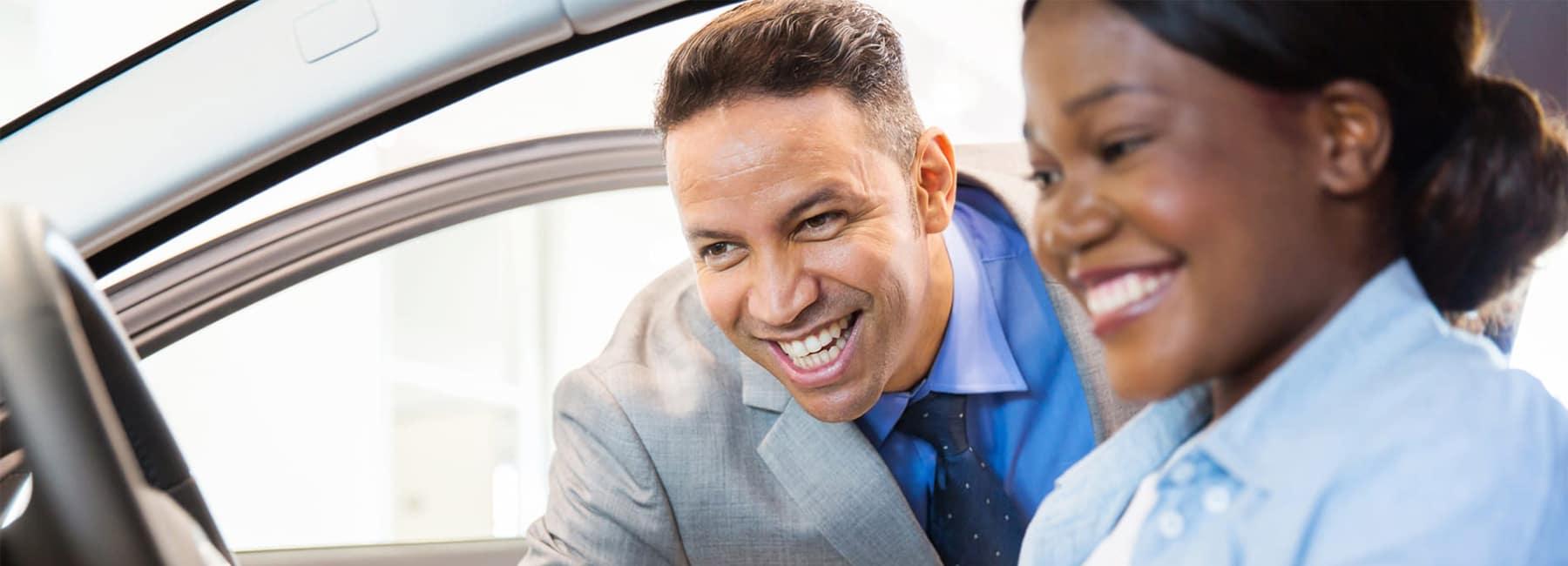 Man and Woman Looking at Car Interior