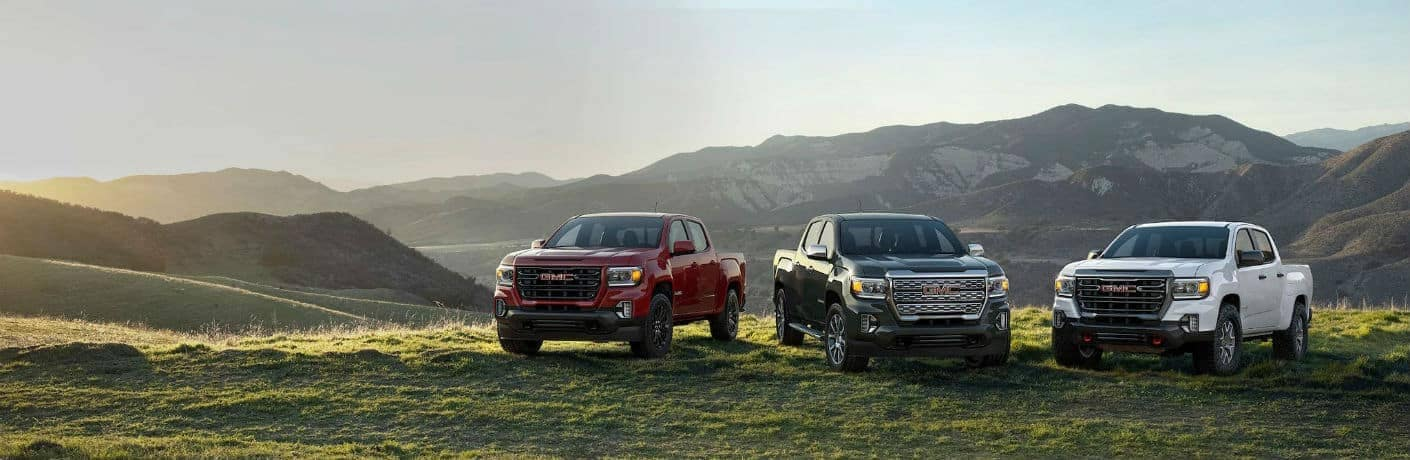2021 GMC Canyon Lineup of Vehicles in a Field