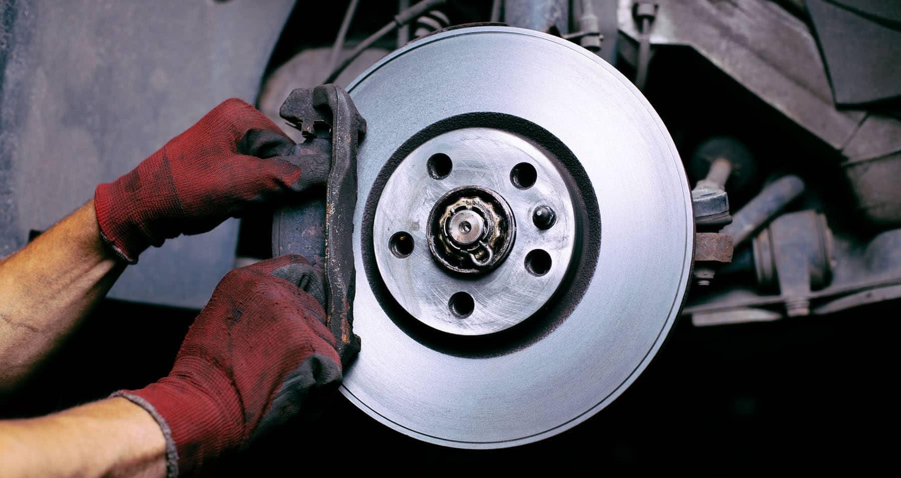 brake pad being replaced
