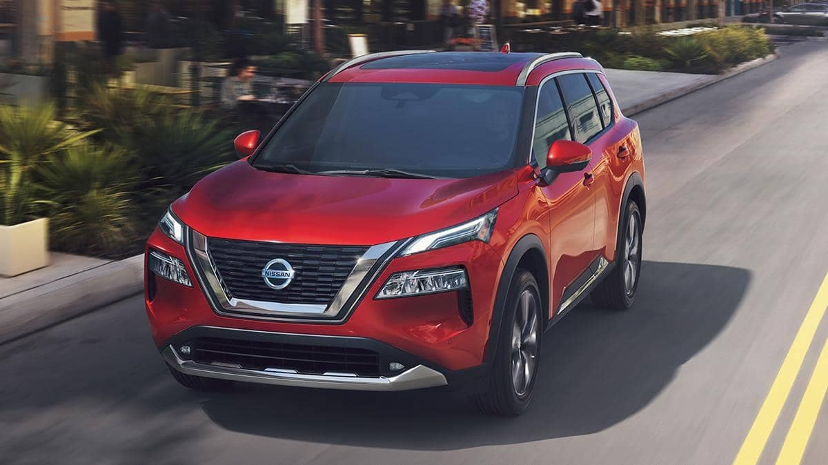 2021 Red Nissan Rogue Driving Down the Street