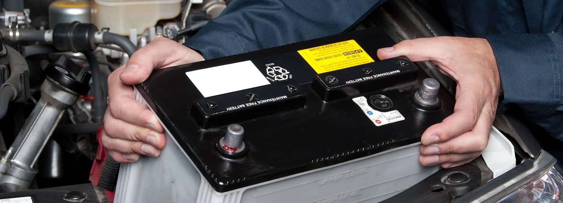 Mechanic installing battery
