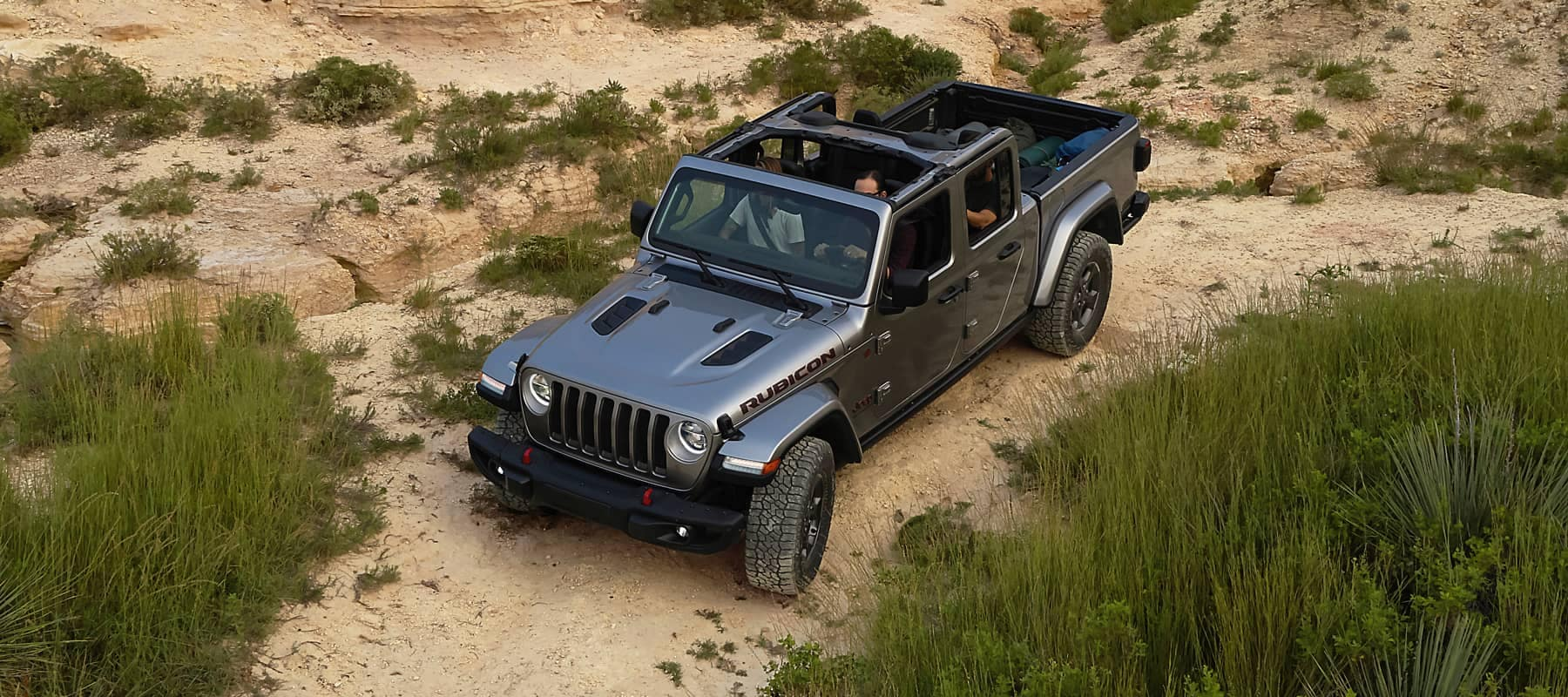 2020 Jeep Gladiator driving on rocky mountain