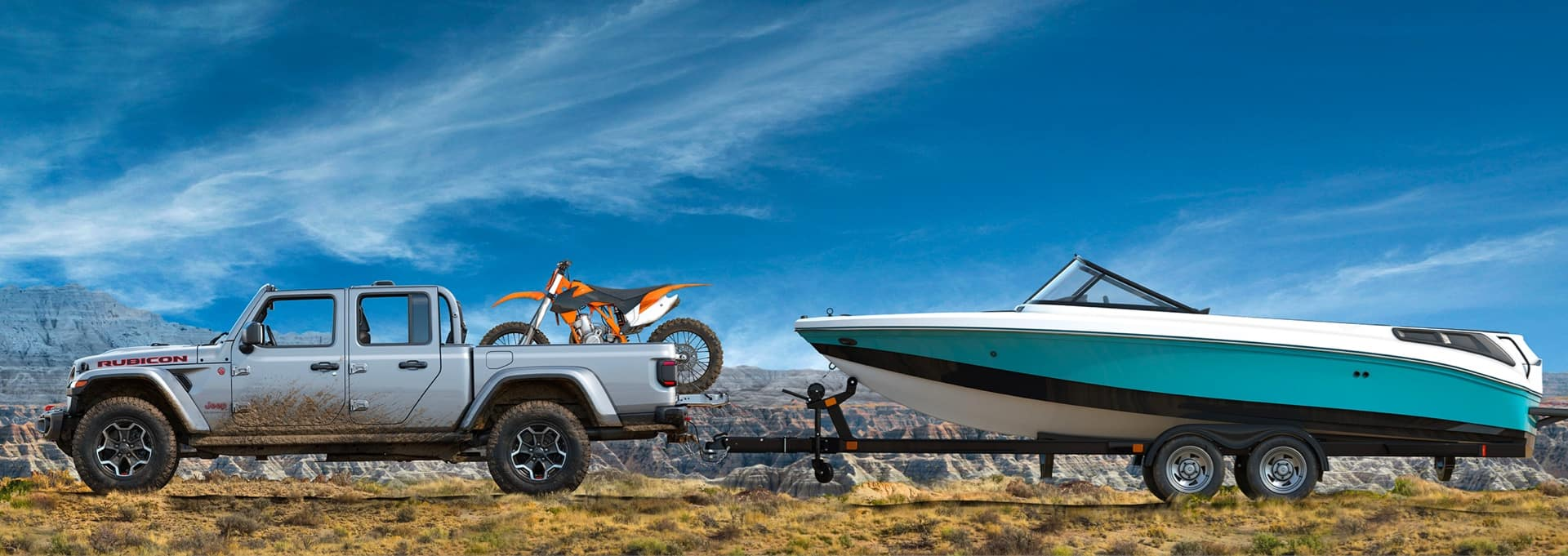 Jeep Pickup, with dirtbike in bed, pulling a boat. while in Desert / Mountainous Terrain